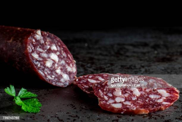 close-up of fresh salami sausage on granite - pepperoni stock photos and pictures