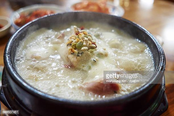 close-up of fresh samgyetang with smoke served in bowl at restaurant - chicken soup stock photos and pictures