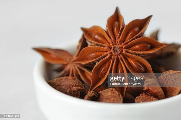 Close-Up Of Fresh Star Anise In Bowl Over White Background