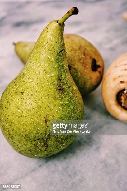 Close-Up Of Fresh Wet Pears On Table