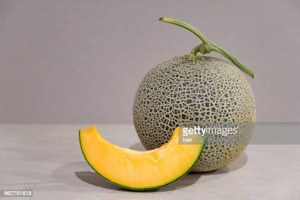 close-up of fresh whole cantaloupe and slices - muskmelon stock pictures, royalty-free photos & images