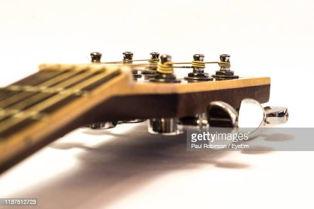 Close-Up Of Fretboard On White Background