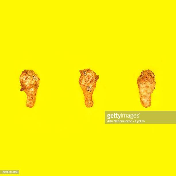 Close-Up Of Fried Chicken Against Yellow Background