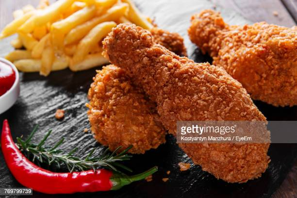 close-up of fried chicken on table - fried chicken stock photos and pictures
