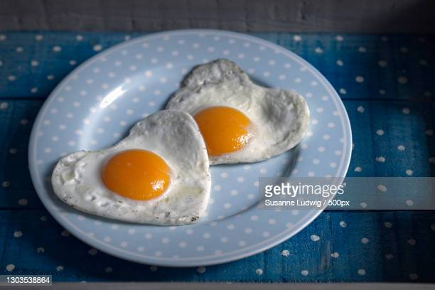 close-up of fried egg in plate on table,germany - susanne ludwig stock pictures, royalty-free photos & images
