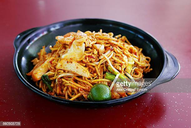 Close-Up Of Fried Noodles In Cooking Pan On Table