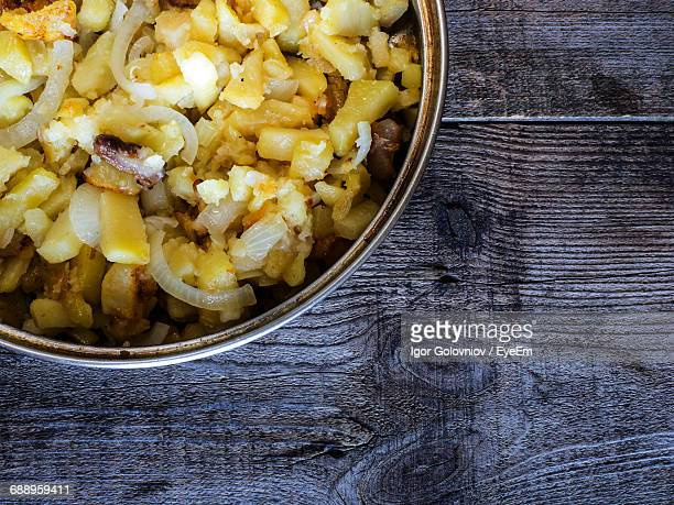 close-up of fried potato in container on wooden table - igor golovniov stock pictures, royalty-free photos & images
