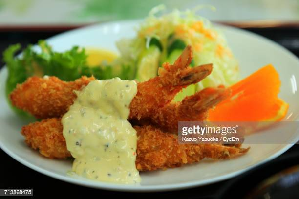 Close-Up Of Fried Shrimp Served With Salad In Plate On Table