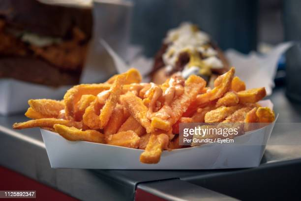 close-up of fries on table - french fries stock pictures, royalty-free photos & images