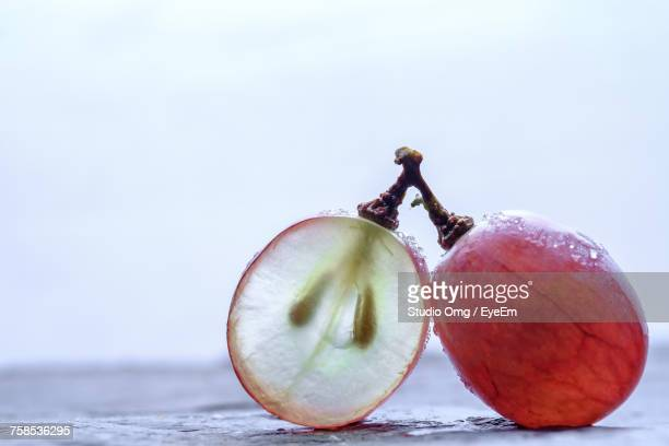 close-up of frozen red grapes on table against sky - grape stock pictures, royalty-free photos & images