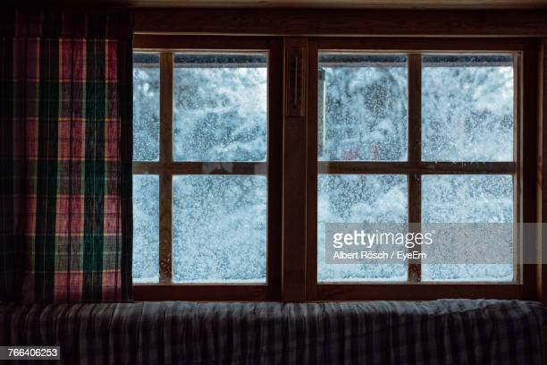 close-up of frozen window at home - window stock pictures, royalty-free photos & images