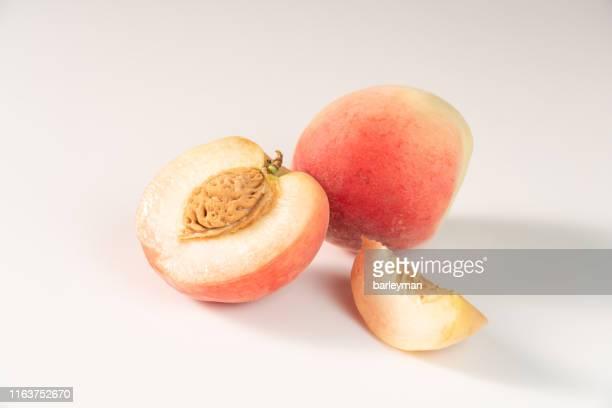close-up of fruit against white background - モモ ストックフォトと画像