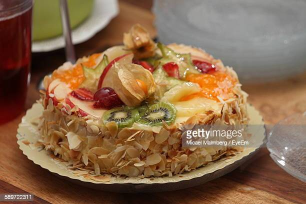 close-up of fruit cake served in plate on table - tropical fruit stock pictures, royalty-free photos & images