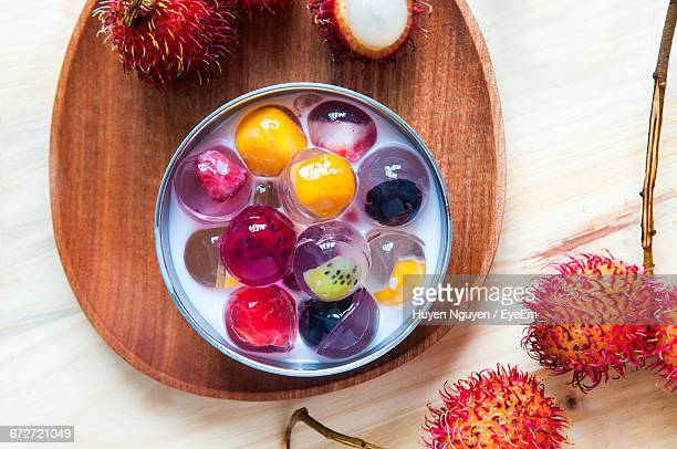 Close-Up Of Fruit Jelly And Rambutans On Table