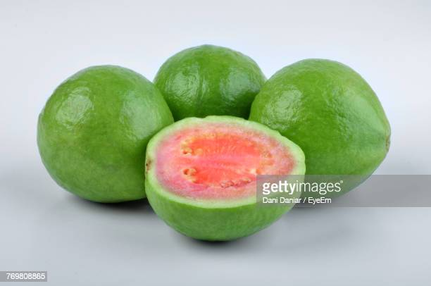close-up of fruits against gray background - guava fruit stock photos and pictures