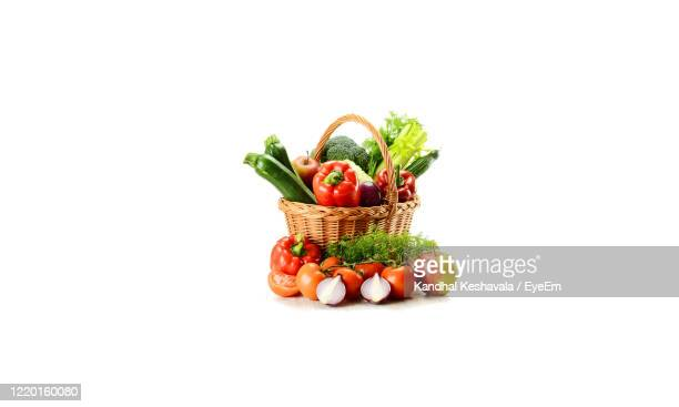 close-up of fruits against white background - vegetables stock pictures, royalty-free photos & images