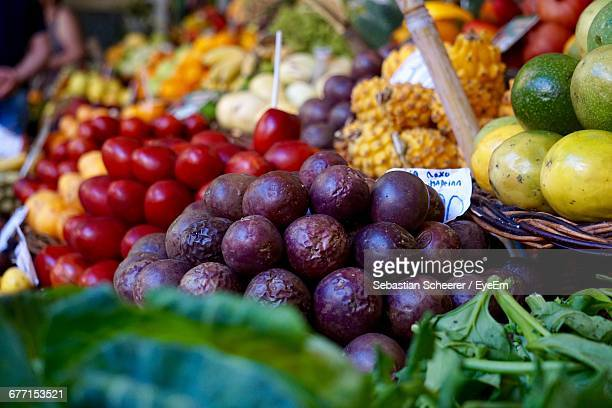 Close-Up Of Fruits And Vegetables For Sale At Market Stall