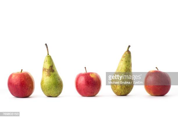 Close-Up Of Fruits Arranged Against White Background