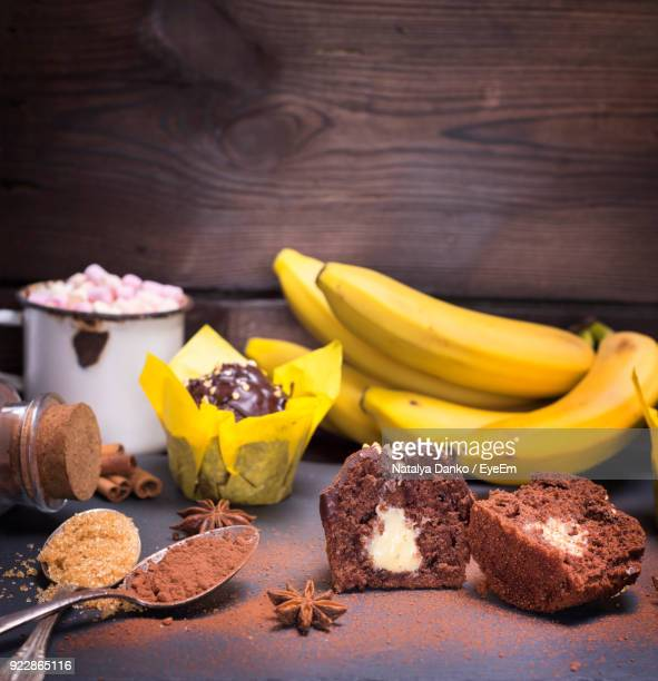 Close-Up Of Fruits Cupcakes And Bananas On Table