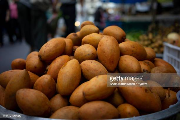 close-up of fruits for sale at market stall - shaifulzamri stock pictures, royalty-free photos & images