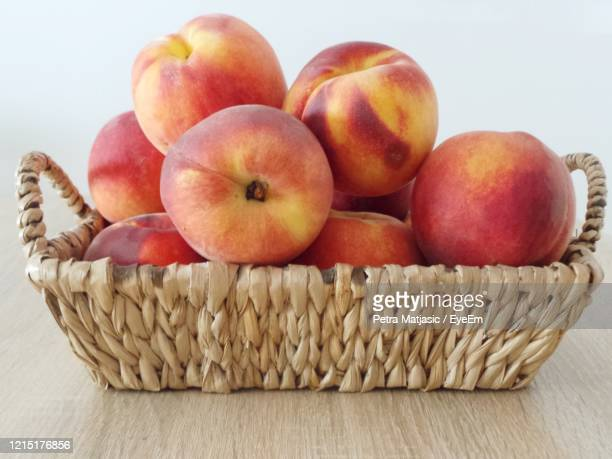 close-up of fruits in basket, peaches - peach colour stock pictures, royalty-free photos & images