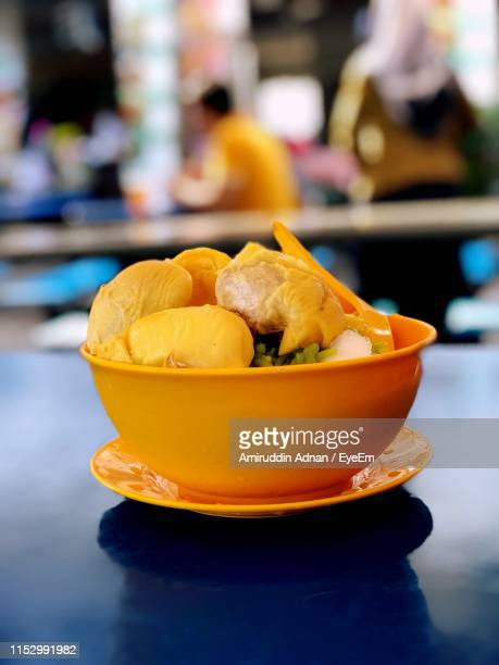 close-up of fruits in bowl on table - shah alam stock photos and pictures