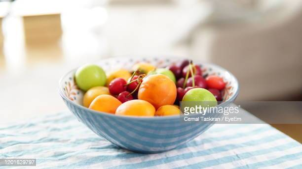 close-up of fruits in bowl on table - 果物の盛り合わせ ストックフォトと画像