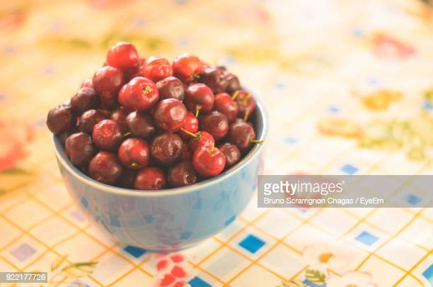 Close-Up Of Fruits In Bowl On Tablecloth