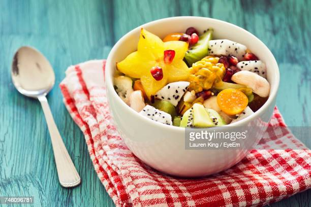 close-up of fruits in bowl - tropical fruit stock pictures, royalty-free photos & images