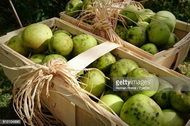 close-up of fruits in box outdoors - roman pretot stock-fotos und bilder