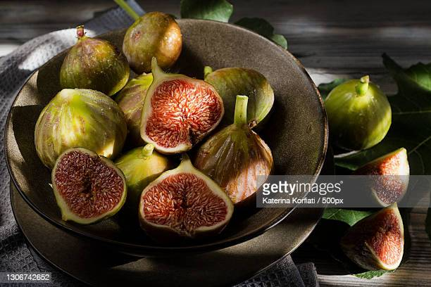 close-up of fruits in plate on table - cross section stock pictures, royalty-free photos & images
