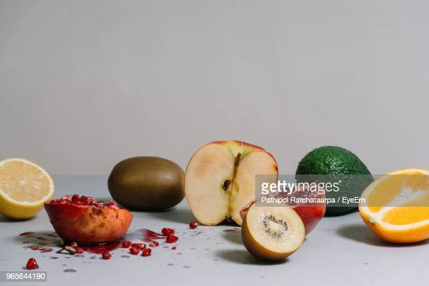 close-up of fruits on table against gray background - crushed stock pictures, royalty-free photos & images