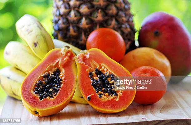 close-up of fruits on table - papaya stock photos and pictures
