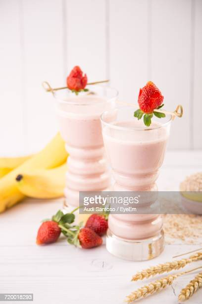 close-up of fruits on table - strawberry milkshake and nobody stock pictures, royalty-free photos & images
