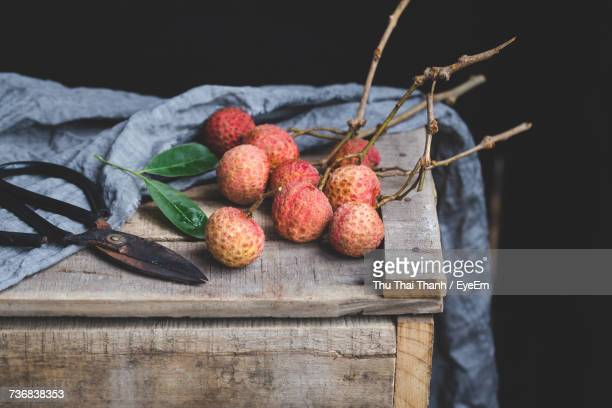 Close-Up Of Fruits On Wood