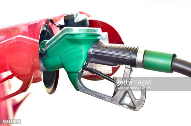 Close-Up Of Fuel Pump Against White Background