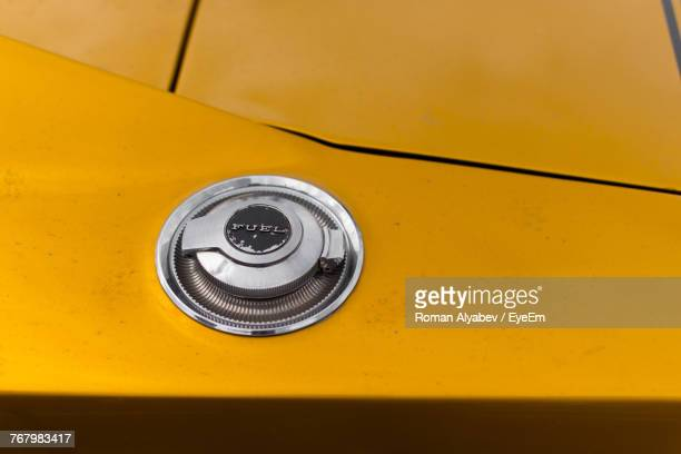close-up of fuel tank on yellow car - fuel storage tank stock photos and pictures