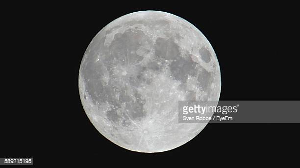 Close-Up Of Full Moon Against Clear Sky At Night