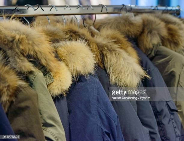Close-Up Of Fur Coats Hanging On Coathangers