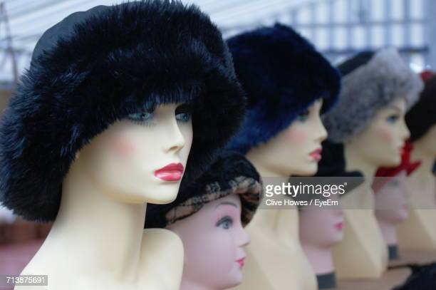 close-up of fur hat on mannequins at store for sale - fur hat stock pictures, royalty-free photos & images
