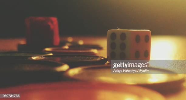 close-up of gambling chip with dice on table - gambling table stock pictures, royalty-free photos & images