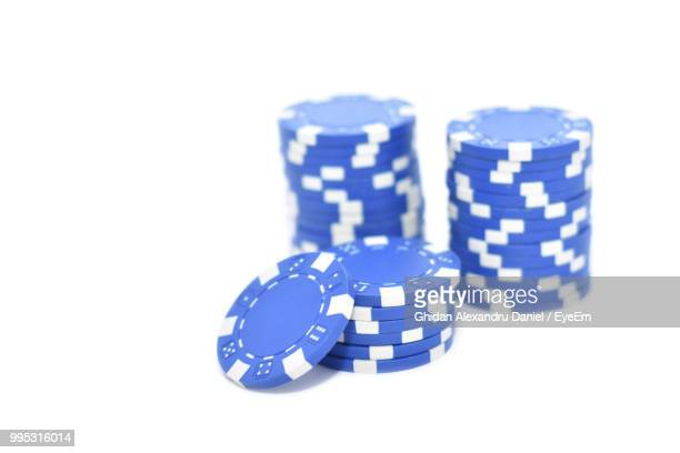 Close-Up Of Gambling Chips Against White Background