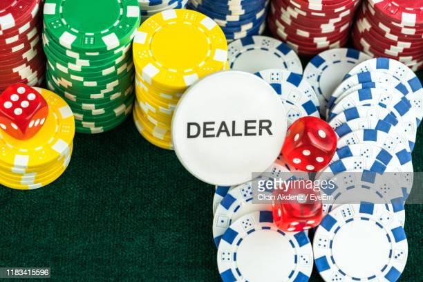 close-up of gambling chips and cards on table - gambling table stock pictures, royalty-free photos & images