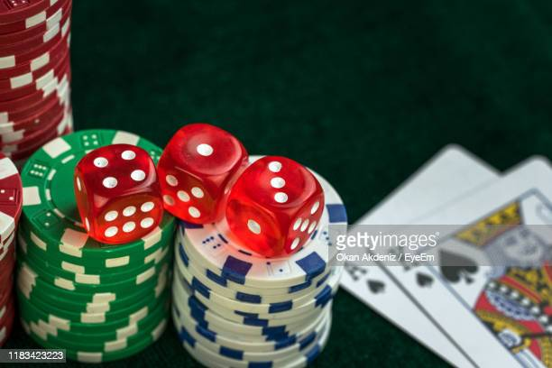close-up of gambling chips on table - gambling table stock pictures, royalty-free photos & images
