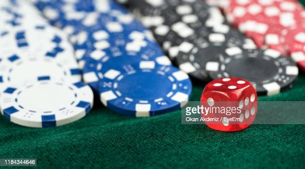 close-up of gambling equipment on table - gambling table stock pictures, royalty-free photos & images