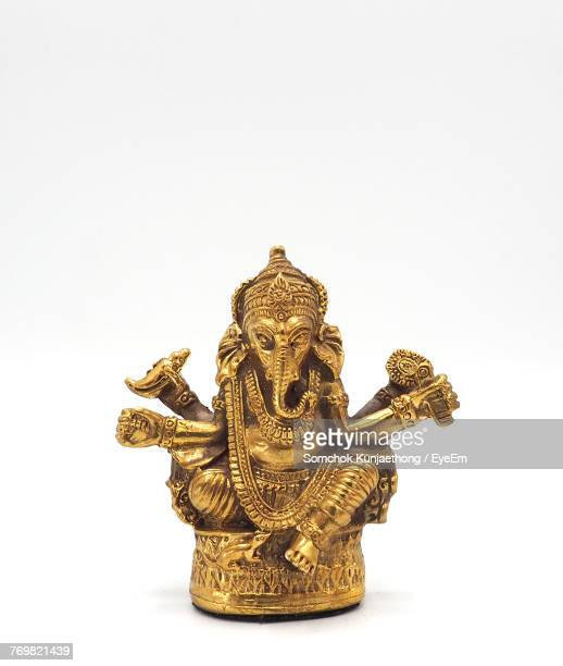 close-up of ganesha figurine against white background - ganesha stock photos and pictures