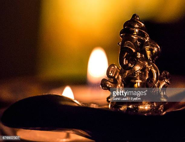 close-up of ganesha statue on table - hindu god stock photos and pictures