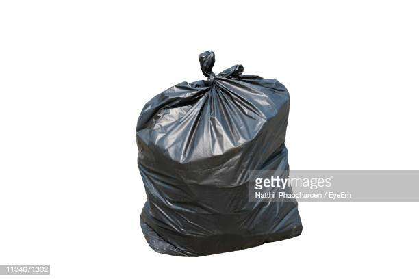 close-up of garbage bag against white background - bin bag stock pictures, royalty-free photos & images