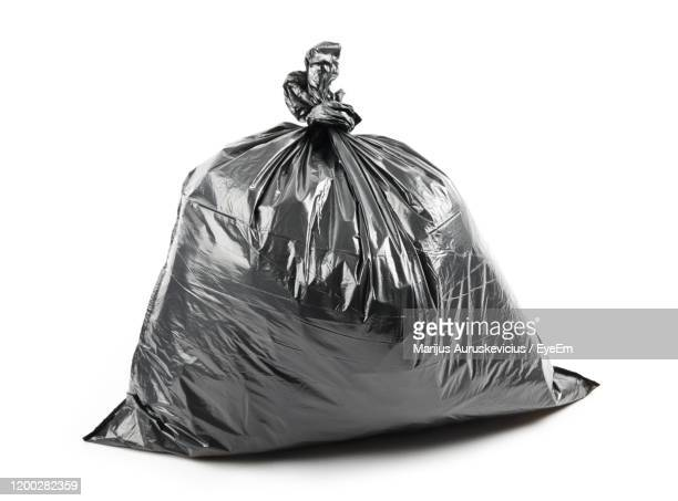 close-up of garbage bag on white background - bin bag stock pictures, royalty-free photos & images