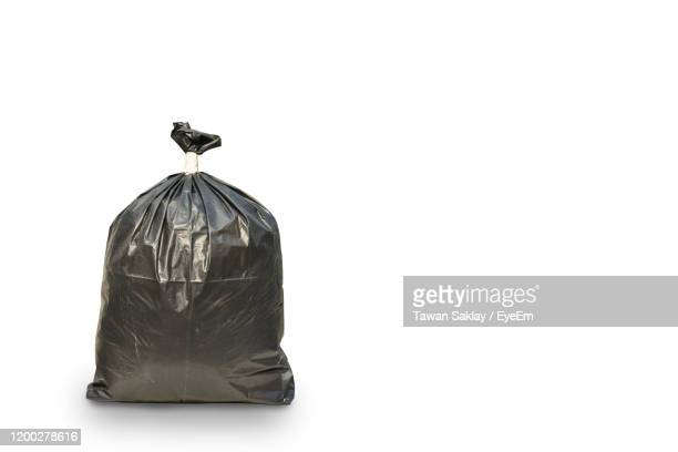 close-up of garbage bag over white background - bin bag stock pictures, royalty-free photos & images